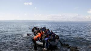 Afghan migrants arrives on the shores of the Greek island of Lesbos after crossing the Aegean sea from Turkey on a inflatable dinghy, Thursday, Sept. 24, 2015. More than 260,000 asylum-seekers have arrived in Greece so far this year, most reaching the country's eastern islands on flimsy rafts or boats from the nearby Turkish coast.(AP Photo/Petros Giannakouris)